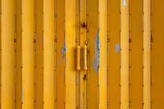 Yellow metal gate Stock Images