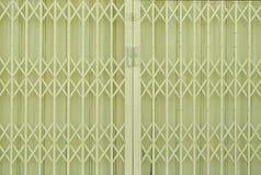 Yellow metal grille sliding door Stock Photography