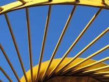 Yellow Metal Hay Rake Tines Against Blue Sky. Photo of a portion of hay-racking equipment, the raking wheel Stock Image