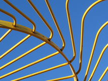 Yellow Metal Hay Rake Tines Against Blue Sky Royalty Free Stock Photography