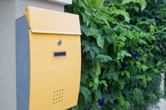 Yellow metal mailbox Stock Image