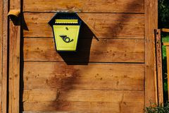 Yellow metal mailbox on a wooden wall. A series of pictures stock image