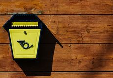 Yellow metal mailbox on a wooden wall. A series of pictures Stock Photos