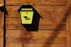 Yellow metal mailbox on a wooden wall. A series of pictures stock images