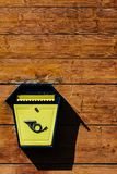 Yellow metal mailbox on a wooden wall. A series of pictures Royalty Free Stock Images