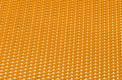 Yellow metal mesh plating Stock Images