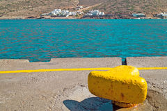 Yellow metal mooring at harbor on Sifnos island Royalty Free Stock Image