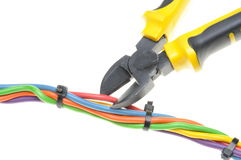 Yellow metal nippers and cable Royalty Free Stock Images