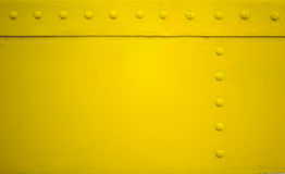 Yellow metal plate with rivet for grunge or abstract background. Stock Photos