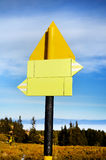 Yellow metal Road sign board. Yellow metal Road sign board in the mountain stock photography