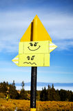 Yellow metal Road sign board.smile. Yellow metal Road sign board in the mountain stock image