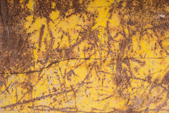 Yellow metal with rust and scratches Royalty Free Stock Photos