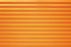 Yellow metal security roller door background Stock Image