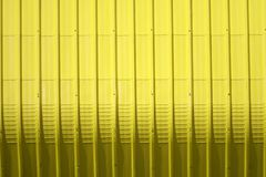Yellow metal sheet pattern and vertical line design. Metal sheet pattern and vertical line design on surface abstract aluminum architecture background blank stock photos