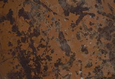 Yellow metal sheet with rust spots. Has brown tones stock photo