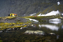 Yellow metal shelter by lake Stock Photo