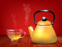 Yellow metal teapot and glass cup of tea Royalty Free Stock Images