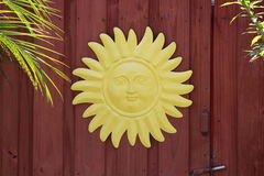 Yellow metal tin sun Stock Photography