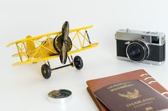Yellow metal toy plane with travel objects on white. Yellow metal toy plane with travel objects isolated on white Stock Image
