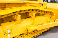 Yellow metall caterpillar band Stock Image