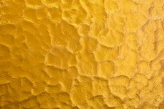 Yellow metallic foil background. Shiny yellow metal foil texture abstract background.  stock image