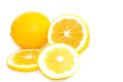 Yellow Meyer Lemons on White Background. Whole and cut slices of bright yellow meyer lemons on white background.  Space for copy Stock Photography