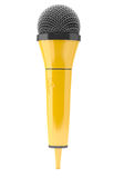Yellow microphone on blue background Royalty Free Stock Image