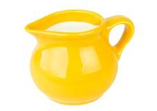 Yellow milk jug Stock Images