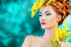 Yellow mimosa. Portrait of a beautiful girl with mimosa flowers. Spring royalty free stock images