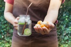 Yellow mini cakes and lime Infused detox water Stock Photos