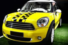Yellow mini car Royalty Free Stock Photos