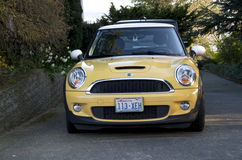 Yellow mini coupe Stock Photography