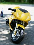 Yellow mini motor bike. Closeup of modern yellow mini motor bike Royalty Free Stock Photography