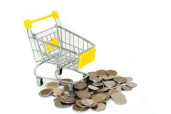 Yellow mini shopping cart or supermarket trolley with pile of silver money coins Bath isolated on white background. Shopping Online Concept : Yellow mini Royalty Free Stock Photo