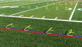 Yellow mini training hurdles set up on turf field royalty free stock images