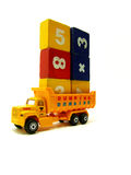 Yellow miniature truck. Loaded with blocks or cubes featuring numbers Royalty Free Stock Photos