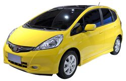 Yellow minivan isolated Stock Photography