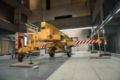 Yellow mobile industrial crane in a building Stock Images