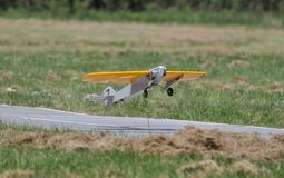 Yellow Model Plane Flying Royalty Free Stock Image