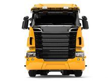 Yellow modern heavy transport truck - front view Stock Photography