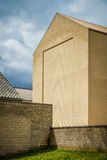 Yellow modernism - giant unornamented brick facade Stock Image