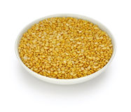 Yellow moong dal, skinned and split mung bean. In a small dish stock photos