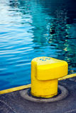 Yellow mooring bollard stock photography