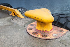 Yellow mooring bollard Stock Photos