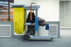 Yellow mop bucket and set of cleaning equipment Royalty Free Stock Photos