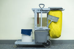 Yellow mop bucket and set of cleaning equipment Royalty Free Stock Image