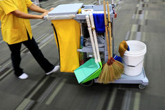 Yellow mop bucket and set of cleaning equipment in the airport royalty free stock photos