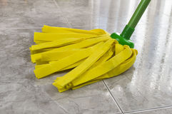 Yellow mop cleaning Royalty Free Stock Photos