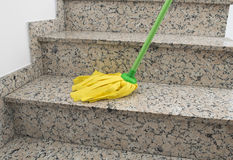 Yellow mop cleaning Stock Photography