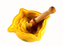 Yellow mortar with garlic sauce Stock Image